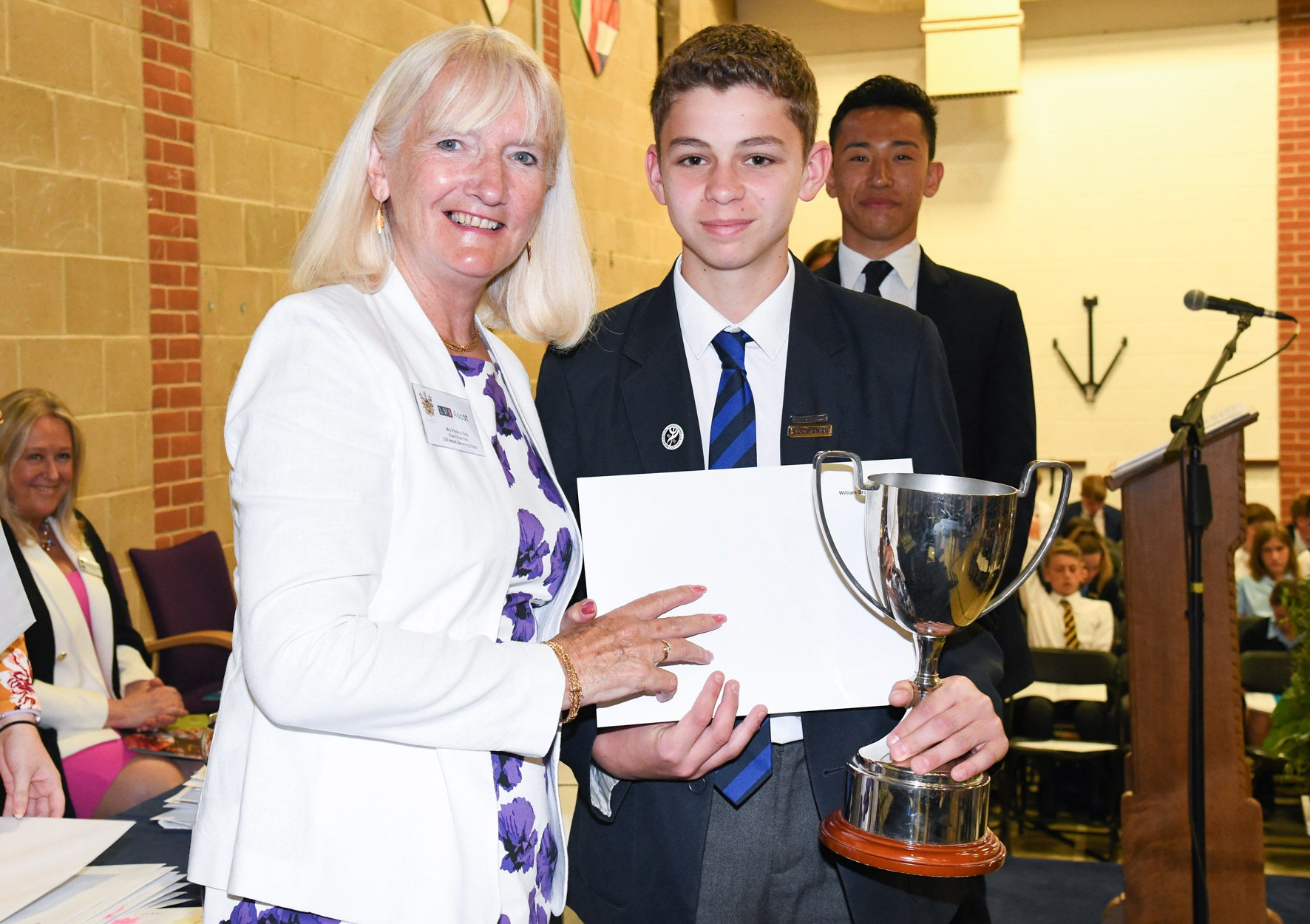 08.07.19. Year 9 student William Brooke collects his three awards at President's Day having been given the gift of confidence from the school according to his mot