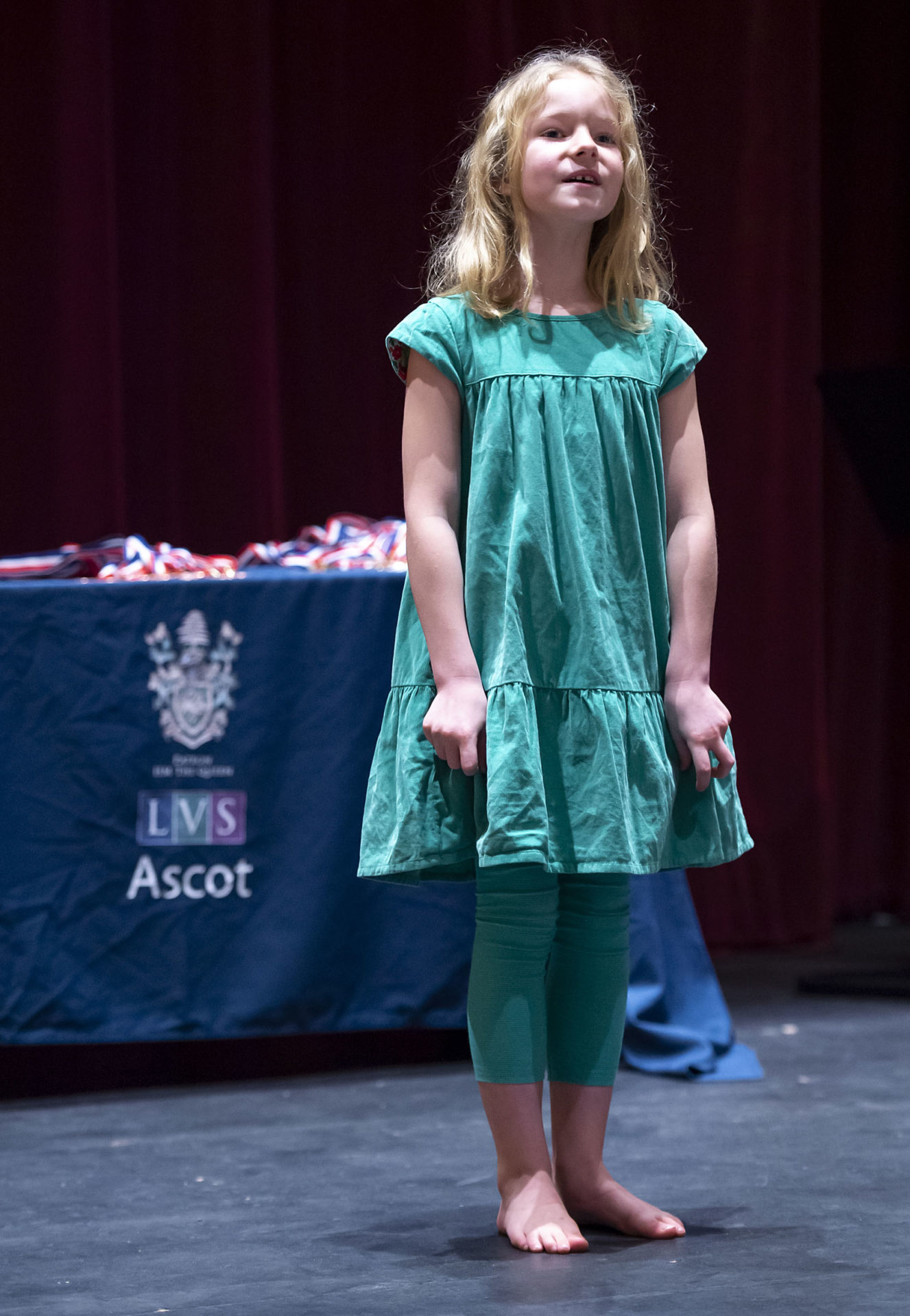 young girl performs on stage in the theatre at lvs ascot